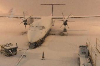 Из-за снегопада в Англии закрылись два аэропорта и сотни школ