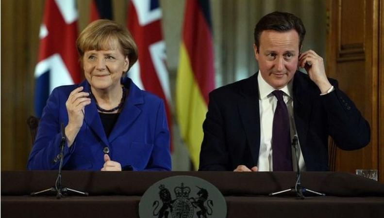 Меркель и Кэмерон рассказали когда отменят санкции