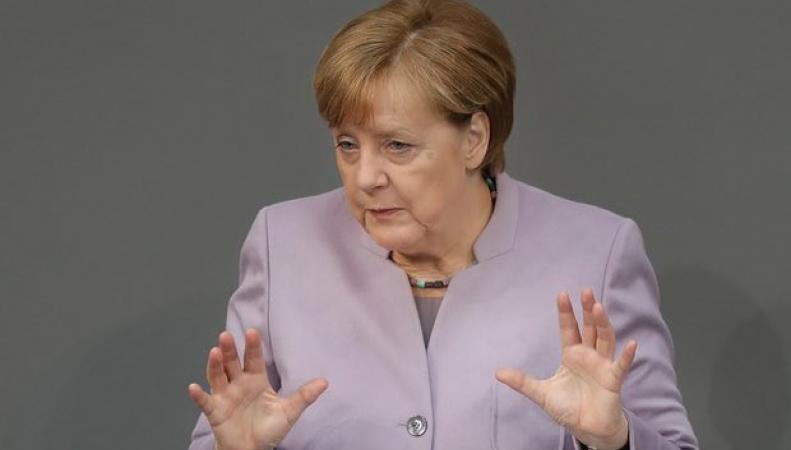 Меркель попросила британское правительство не питать иллюзий о выгодной сделке с ЕС фото:theguardian