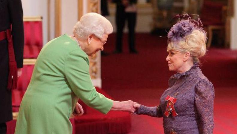 награждение в Букингемском дворце